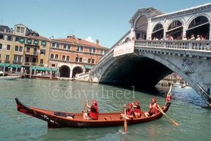 2. Kwakiutl Canoe in Venice, Italy: Walas-Kwis-Gila (Travels Great Distances) Canoe on the Grand Canal in Venice, Italy  Pacific Northwest Coast Native Indian Canoe  This traditoinal dug-out Canoe was made from a 500 year old red cedar log; it paddled on many journeys in B.C and Washington state; it traveled to Venice, Italy, where it paddled on the Grand Canal.  Read more at: davidneel.com.