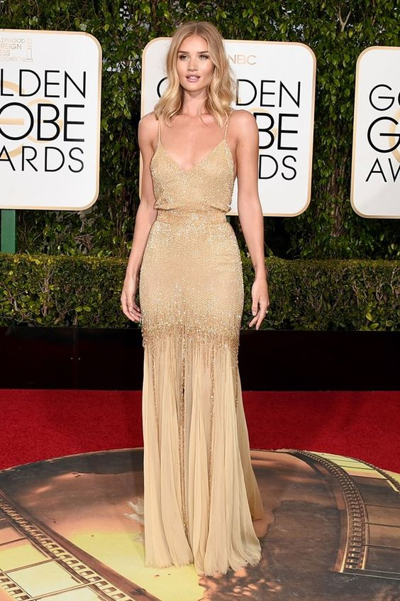 Golden Globes 2016: Rosie Huntington-Whiteley in a gold dress