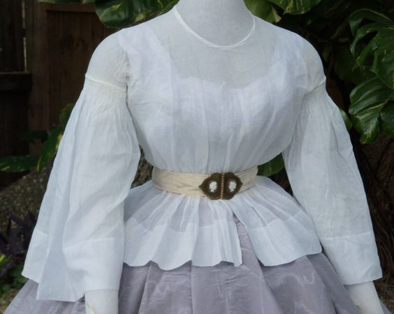 Muslin basque with moire belt and skirt c.1858: