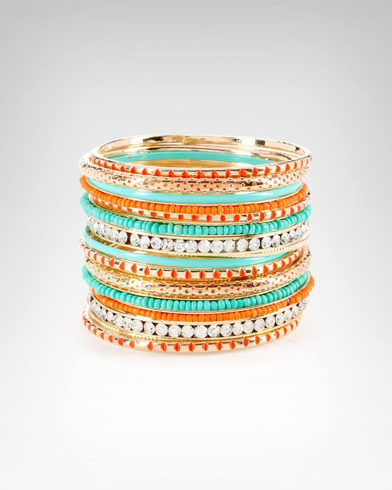 #bebe #wishesanddreams 8. A glam piece of jewellry - these multicoloured and textured bangles will help to bring even a simple bikini-and-coverup ensemble together!