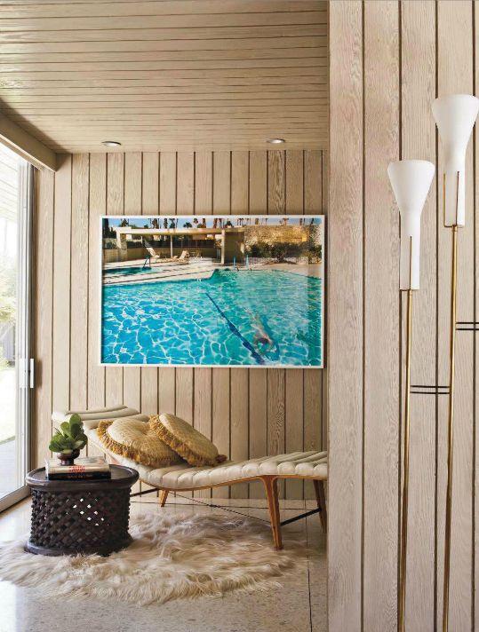 Swimming pool photograph, lounge chair, fur rug, brass floor lamp