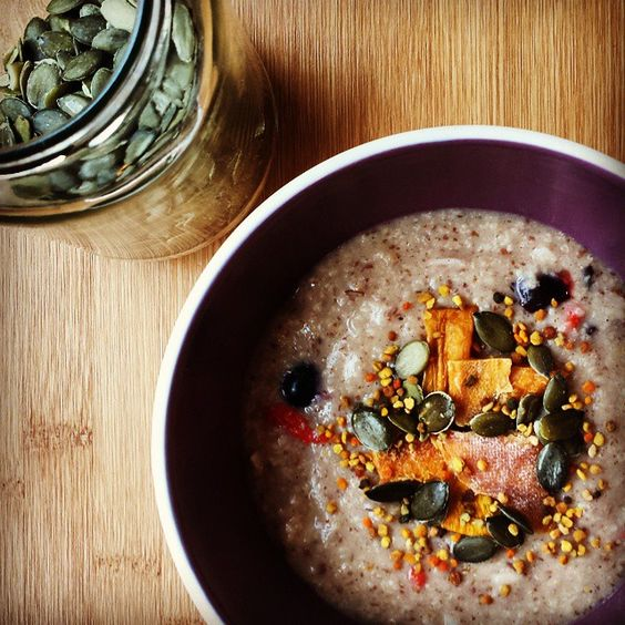 It's raining outside and I'm generally feeling a bit tropical this morning. I added a few flakes of coconut and pieces of dried mango to pep up my millet porridge (and, feeling a bit wild for a Sunday, grated in some creamed coconut too!). #porridgediaries #porridge #breakfast #healthy #vegan #vegetarian #hbloggers #coconut
