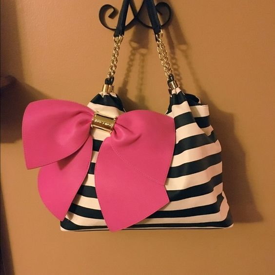 Betsey Johnson candy striped bownanza bag Awesome EUC Betsey Johnson candy striped big bownanza bag. Black and white striped with big pink bow. Large with tons of space Betsey Johnson Bags