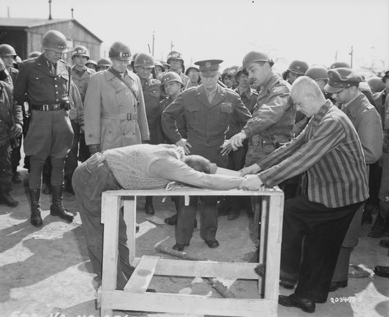 Generals (from right to left) Dwight Eisenhower, Omar Bradley and George Patton are given a demonstration of one of the methods of torture used by the SS guards in the Gotha concentration camp.