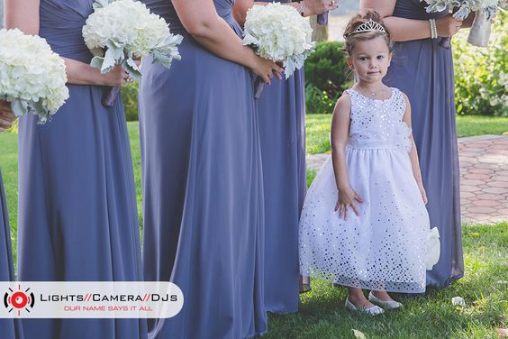 We love this little cutie from Kelly & Greg's wedding at Saint Clements Castle! How adorable is she?