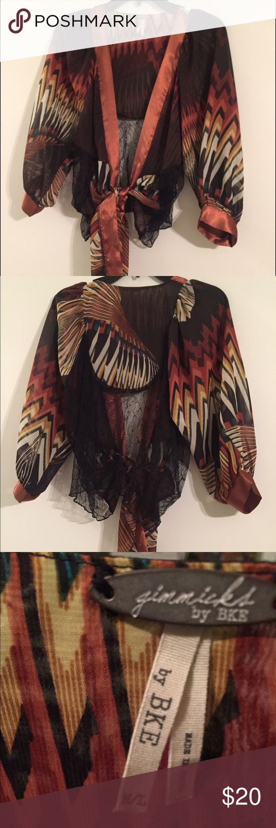 Gimmicks by BKE top Beautiful top by BKE, beautiful gold, Browns, blacks with lace that can be worn over a camisole and would dress be great to dress up jeans. BKE Tops Blouses