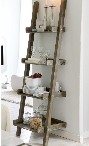 Always looking for cool ladder ideas, use old cutting boards, old frames, or a drawer that fits and nail it into the rung! Or do what they did and frame in a little shelf for each rung. Love it!: