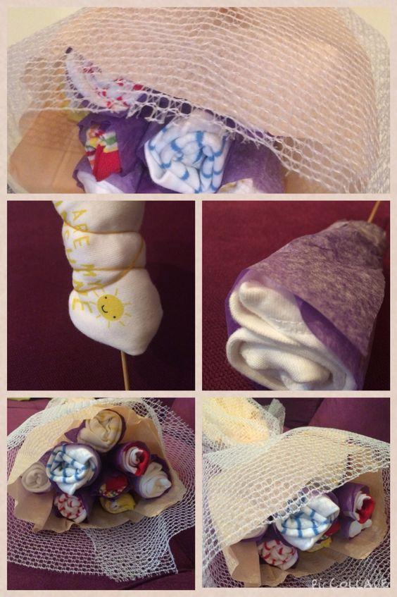 Bebek çorap ve bodysinden çiçek buketi..