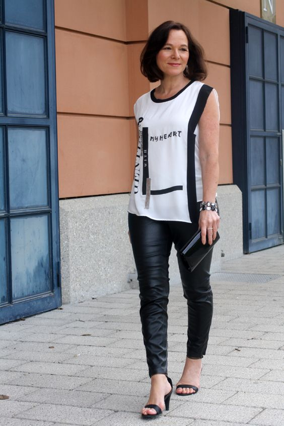 Party look in black leather leggings and a sleeveless top - style over 50