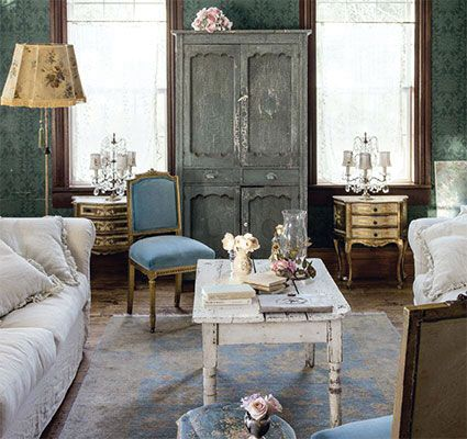 Rachel is known for her ability to combine elegant elements such as the gilded florentine table and crystal light fixtures with rougher pieces such as the coffee table and armoire.