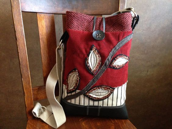 A CROSSBODY HOBO BAG that is simply stated in both design and style! I designed this bag with repurposed fabrics and new materials in a red,