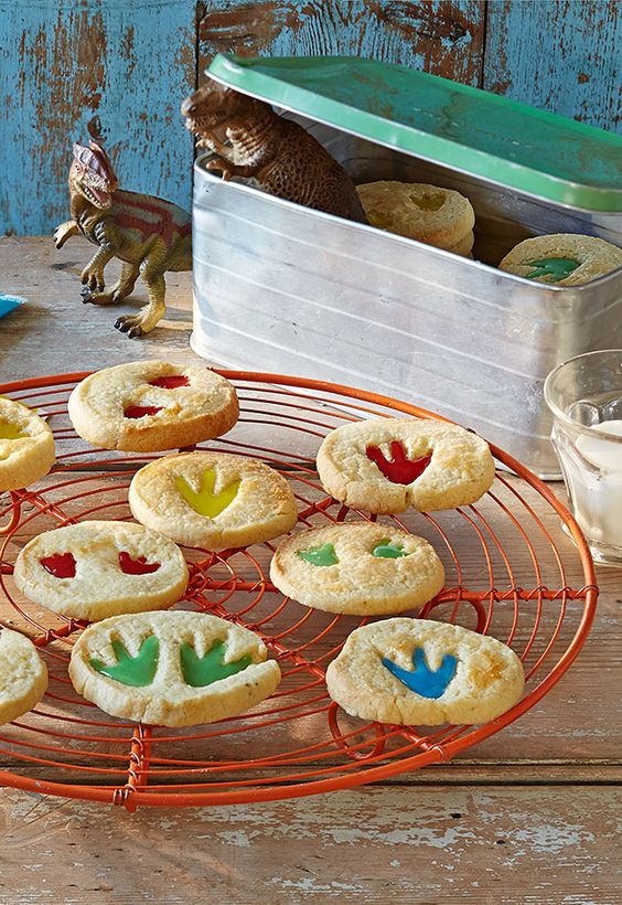 Things are getting Jurassic... Fill dino foot indents with colourful icing to make these cool dinosaur biscuits!