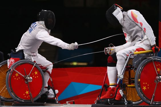 Ruyi Ye (left) of China on his way to winning gold against Yijun Chen of China during the Men's Individual Foil Category A final of the Wheelchair Fencing on day 6 of the London 2012 Paralympic Games at ExCel on Sept. 4. (Michael Steele/Getty Images) #
