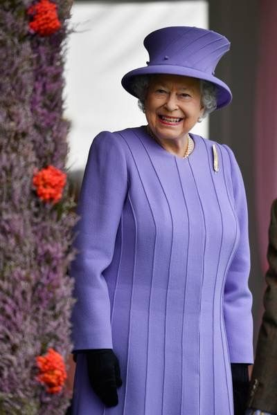 Queen Elizabeth II watches competitors at the Braemar Gathering on September 3…