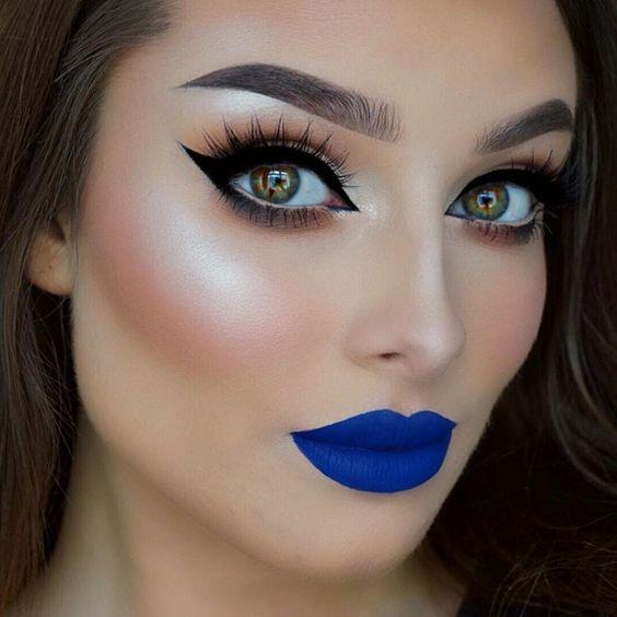 """Blue lips and sharp winged liner Eyes - @toofaced Chocolate Bar palette. @nyxcosmetics Matte Liquid liner. @hudabeauty @shophudabeauty lashes in Sasha.…"""