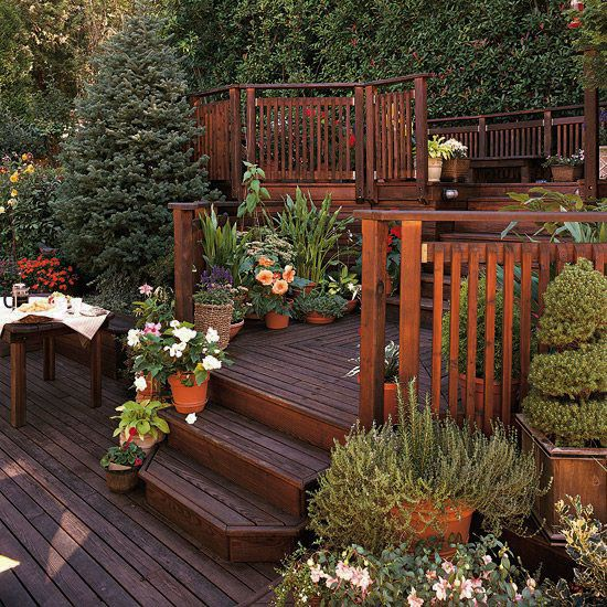 Inspiring Deck Ideas Using Pallets Just On Miraliva Com Sloped Backyard Backyard Design Backyard