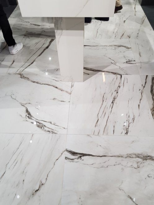 Statuario Plus And Greystone Smoke By Peronda The Classical Marble Looking Tiles Are Available In Three Sizes 90 90 60 120 Ceramic Tiles Wet Rooms Exhibition