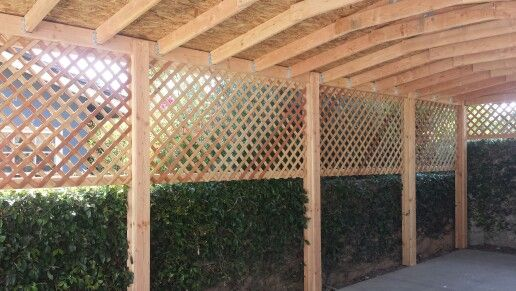 Covered carport with lattice siding designed and built for Trellis carport