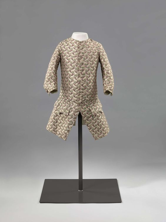 Boy's coat, 1760-1775. White silk, woven with fine floral and foliate motifs in purple and green.