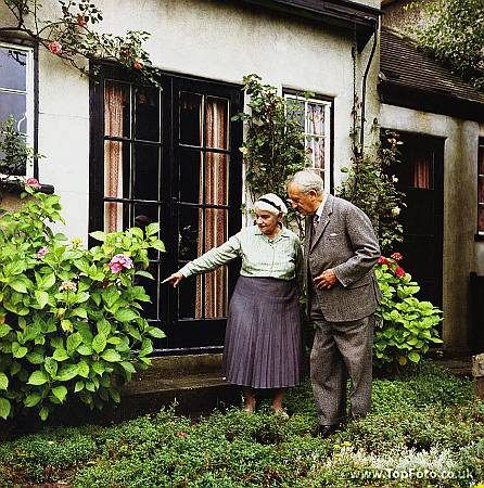 JRR TOLKIEN ;John Ronald Ruel Tolkien ;Photographed in his garden with his wife Edith at 76 Sandfield Road , Oxford ;1966 ;English writer , poet and university professor ;Credit : Pamela Chandler / ArenaPAL www.arenapal.com: