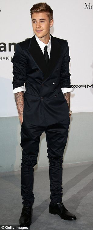 So close: The pop star nearly looked dapper in his classic suit, but wanted to put his tat...