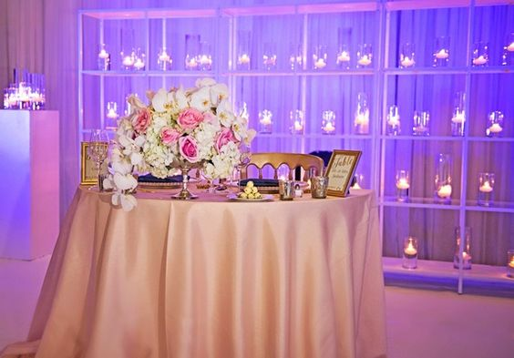 Sweetheart Table with Low Floral Arrangement | Photography: Carasco Photography. Read More:  http://www.insideweddings.com/weddings/church-ceremony-with-nigerian-traditions-chic-ballroom-reception/845/