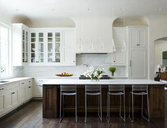 white kitchen with wood island