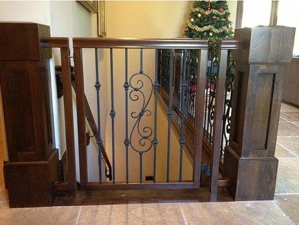 The wrought iron motif of the hand railing is repeated in this custom wood and iron gate.  Designing a gate might take awhile with all the hand forged metal art and decorative parts, balusters, and panels available. This is similar to how I'm doing mine to match oak & iron.