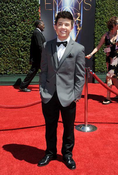Bradley Steven Perryarrives for the 2014 Primetime Creative Arts Emmys.