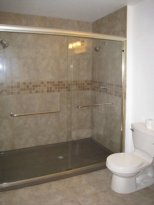 Tiled Shower Walls With Mosaic Accent And ONYX Shower Solid 1 Piece Base.  Elegance And