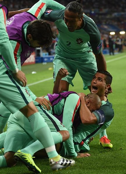 #EURO2016 Portugal's forward Cristiano Ronaldo celebrates with teammates after scoring a goal during the Euro 2016 semifinal football match between Portugal...