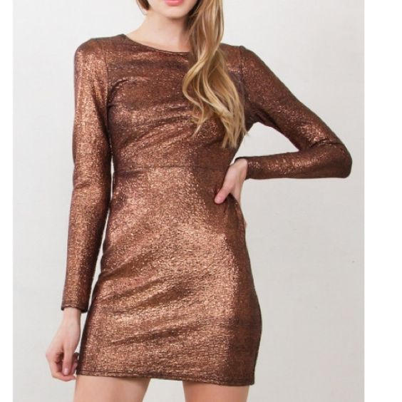 Copper metallic long sleeve body con dress  A holiday dress MUST HAVE!!! Turn heads in this Copper metallic long sleeve body con dress with an open back. Self tie in the back. Zipper closure on back. 97% Polyester, 3% Spandex available in sizes XS S M L Dresses