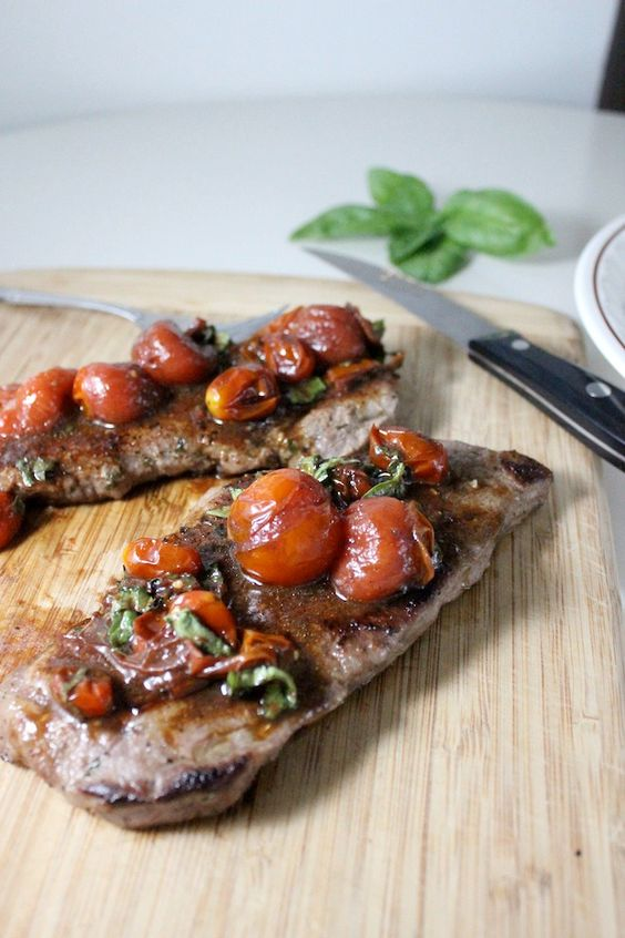 Pan Seared Steak with Balsamic and Basil Cherry Tomatoes- This steak is perfect for a fancy date night in or for large crowd. The balsamic cherry tomatoes burst with flavor!