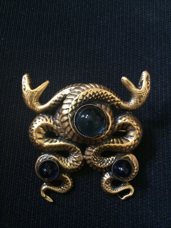 """""""This is a gorgeous snake brooch by Joseff with blue stones in the brooch."""""""