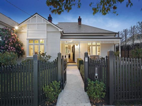 Weatherboard Home Painted In White With Grey Slate And