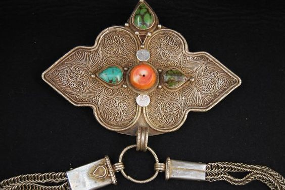 Old Tibetan belt buckle with chain, decorated with a central coral and 3…