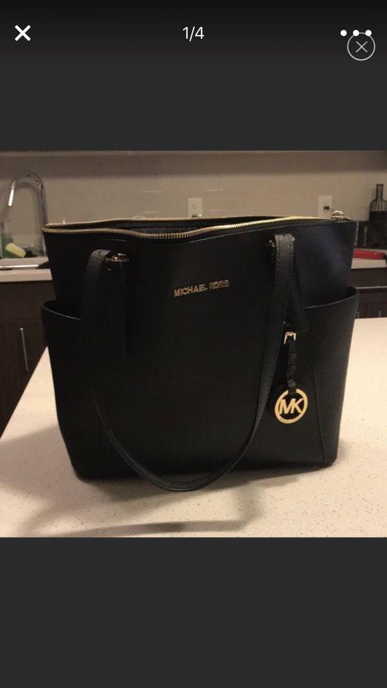d7178e0c549b Michael Kors black and gold shoulder bag. Great condition .
