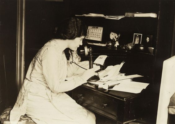 Photograph of Alice Paul, seated at desk, in profile, speaking on telephone, June 1913 | Tumblr