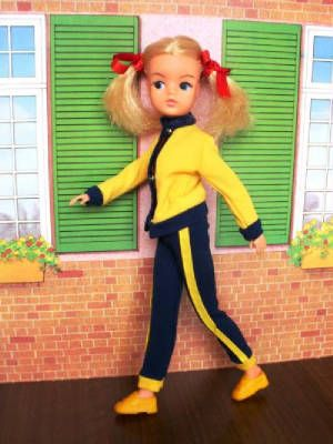 Keep-fit Sindy. I got one of these for my birthday one year. She didn't have her hair in bunches though.