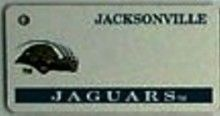 """This is an NFL Jacksonville Jaguars Team License Plate Key Chain or Tag. An excellent and affordable gift for an avid NFL fan! The key chain is available with engraving or without engraving. It is a standard key chain made of durable plastic and size is approximately 1.13"""" x 2.25"""" and 1/16"""" thick."""
