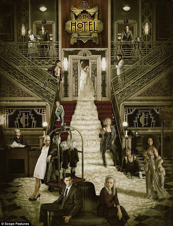 Taking centre-stage: Gaga stands on the staircase with her long hair spilling down to the floor with Angela on the far right as they pose with the cast for American Horror Story: Hotel, Wednesdays on FX