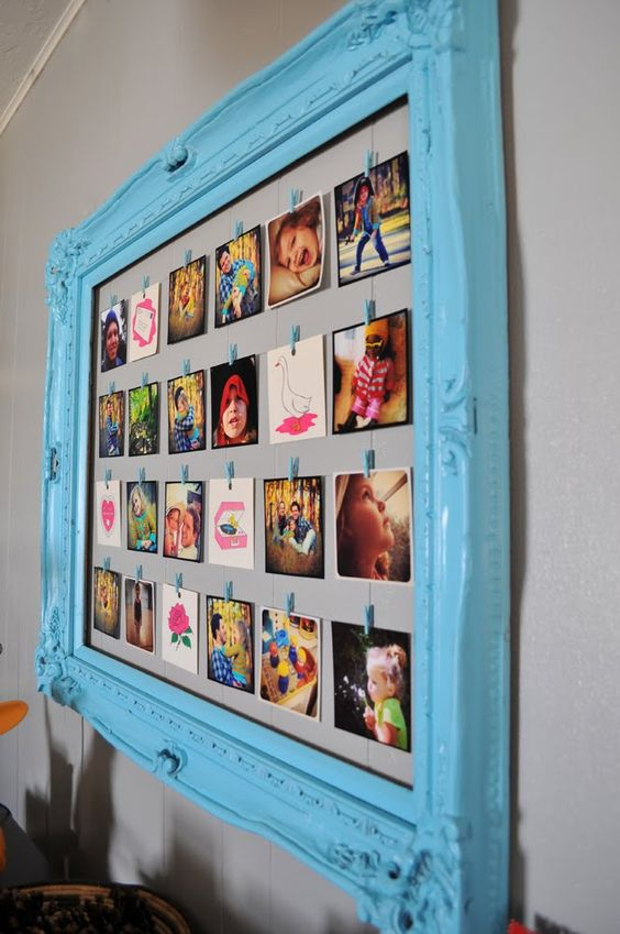 clothesline frame, makes it very easy to change out the pictures-Cute idea instead of photos in one frame