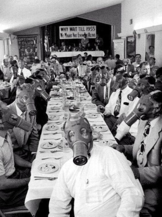 The Optimist Club in wear gas masks for a photo to protest the smog in Los Angeles in 1954.