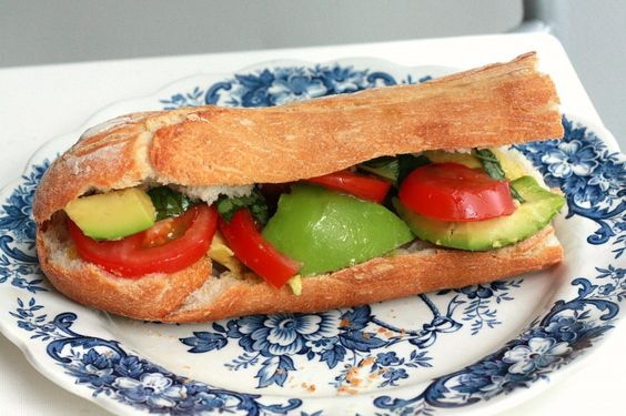 lydia bread: sliced baguette, oil, avocado, feta cheese  tomato avocado baguette: tomato w/ fresh basil & avocado w/ sea salt, extra virgin olive oil & balsamic vinegar