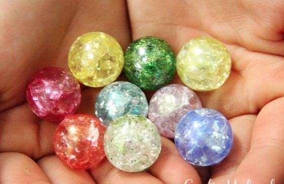 'Crystal' marbles. Bake at 500 for 20 min. Dump into ice water. Marbles will crack inside but not outside.  Use for jewelry or vase filler