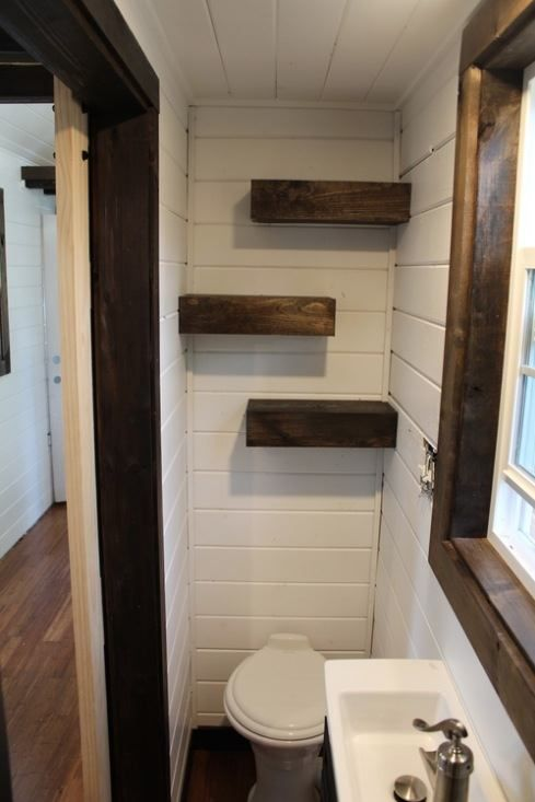 Nice bathroom shelving tiny heirloom luxury tiny house for Tiny toilet ideas
