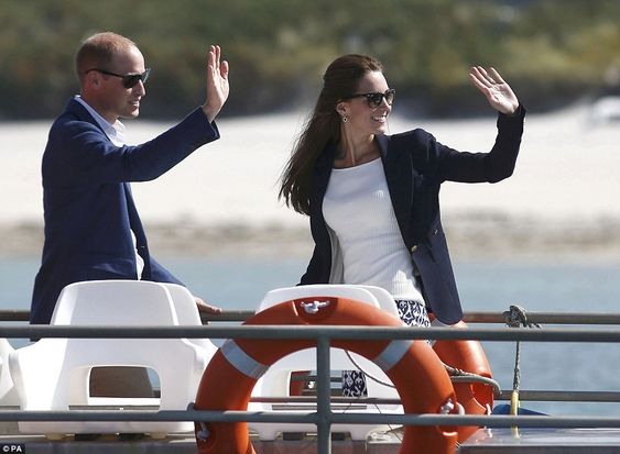 William and Kate wave to onlookers as they depart from Tresco