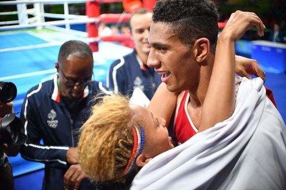 France's Tony Victor James Yoka (R) is congratulated by his wife French boxer and gold medalist Estelle Mossely after he won against Great Britain's Joe Joyce during the Men's Super Heavy (+91kg) Final Bout at the Rio 2016 Olympic Games at the Riocentro - Pavilion 6 in Rio de Janeiro on August 21, 2016.  .France's Tony Victor James Yoka won the match. / AFP / Yuri CORTEZ