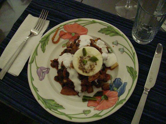 Poached eggs with pulled pork and a Chile caribe base http://ayearofsundays.com/huevos-con-cerdo-tirada-y-crema-eggs-pulled-pork-cream/
