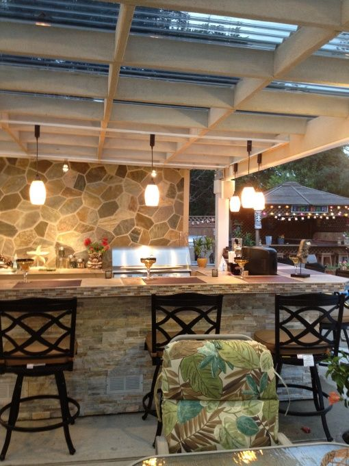 """The patio cover was built using mostly 2x6""""s and SUNTUF corrogated polycarbonate solar grey colored sheets which lets the light but protects from UV."""